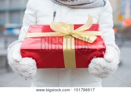 Midsection of woman holding gift box winter