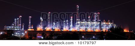 Panoramic view petrochemical oil refinery plant shines at night