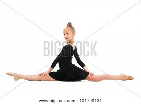 little gymnast stretching on the floor isolated on white background
