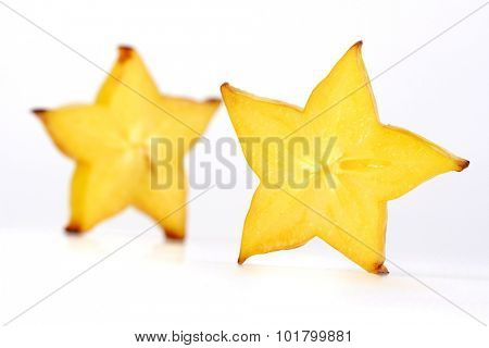 Close-up of carambola on white background