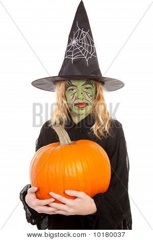 Green Witch For Halloween Holding Pumpkin