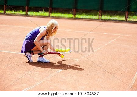 Woman playing tennis and preparing for sports competition.