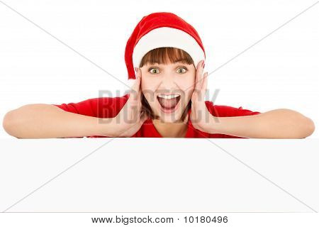 Surprised Woman In Santa Red Hat Leaning On Blank Billboard