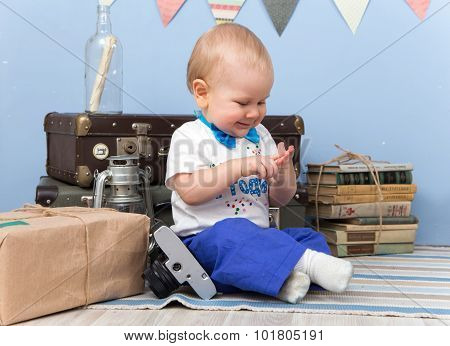Smiling Sitting Little Boy Counts His Fingers At Home