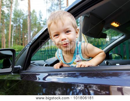Funny Small Kid Looking From Open Car Window