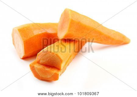 Peeled and sliced carrot isolated on white