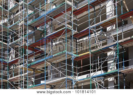 building facade with scaffoldings - construction site