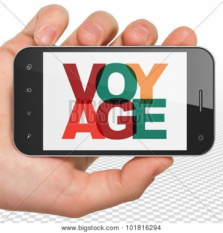 Tourism concept: Hand Holding Smartphone with Voyage on  display