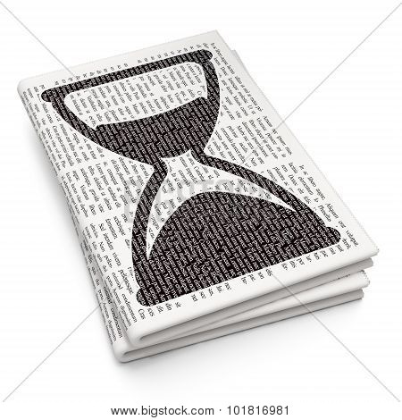 Timeline concept: Hourglass on Newspaper background