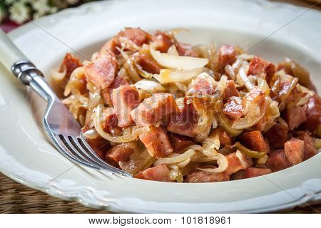 Stewed Onions With Sausage.