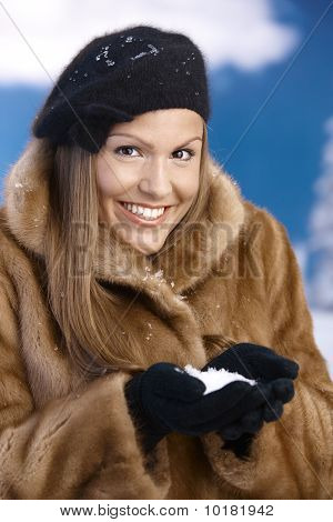 Elegant Young Female Enjoying Winter Snow Smiling
