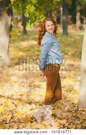 Portrait Of Beautiful Smiling Woman At Autumn Leaves