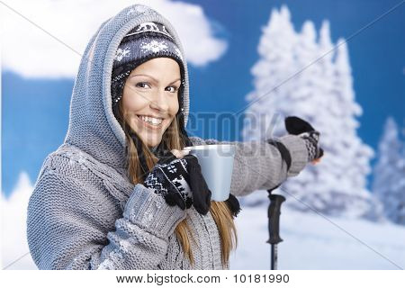 Happy Skier Taking A Break On Top Drinking Hot Tea