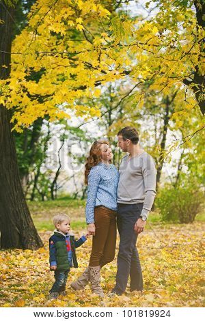 Portrait Of Happy Family In Beautiful Autumn Park