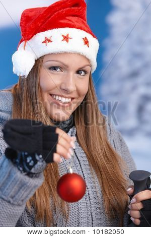 Woman In Santa Hat Holding Christmas Decoration