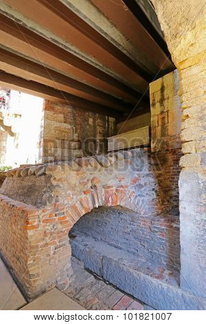VERONA, ITALY - SEPTEMBER 2014 : The medieval gate called Porta del Morbio at Castle Fortress Castelvecchio in Verona, Italy on September 14, 2014. It was discovered during the restoration work