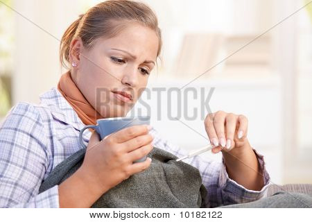 Young Woman Having Flu Taking Her Temperature