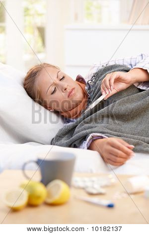 Young Female Having Flu Laying In Bed