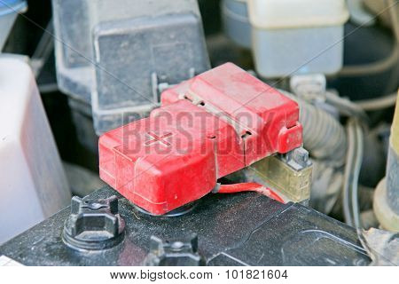 Car Battery With Red Positive Polarity For Auto Concept (selective Focus At Positive Symbol)