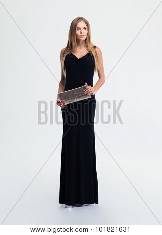 Full length portrait of a fashion woman standing isolated on a white background