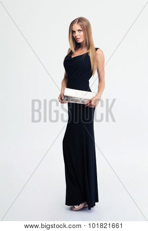 Full length portrait of a charming woman standing in black dress isolated on a white background
