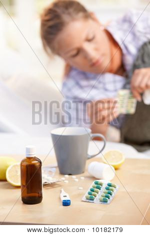 Vitamins Medicines For Flu Woman In Background
