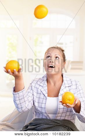 Pretty Girl Juggling With Grapefruits In Bed