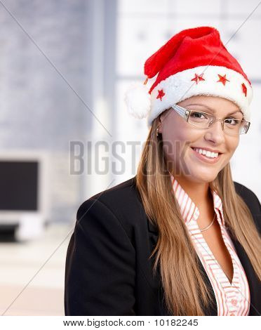 Portrait Of Young Woman In Santa Claus Hat
