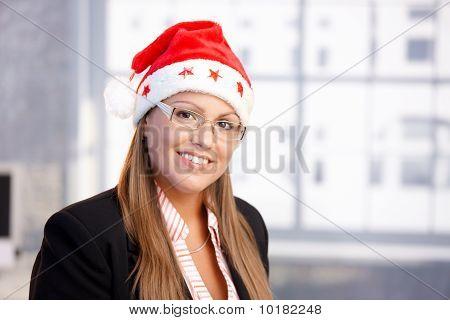 Portrait Of Attractive Female In Santa Claus Hat
