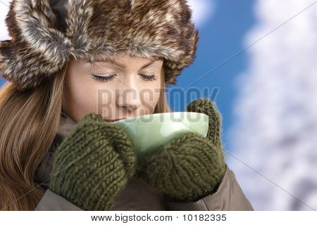 Young Female Dressed Up Warm Enjoying Hot Tea