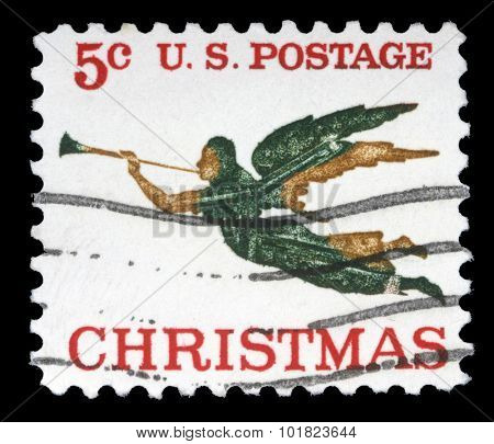 UNITED STATES OF AMERICA - CIRCA 1970s: A greeting Christmas stamp printed in the USA shows angel with horn, circa 1970s