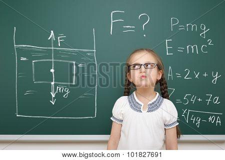 girl drawing physical phenomenon gravity on school board