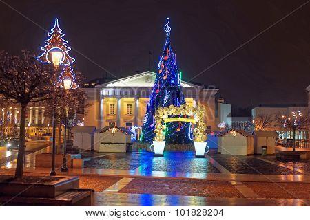 Traditional European Christmas Market With The Illuminated Christmas Tree