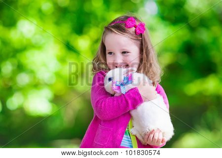 Little Girl Playing With Rabbit