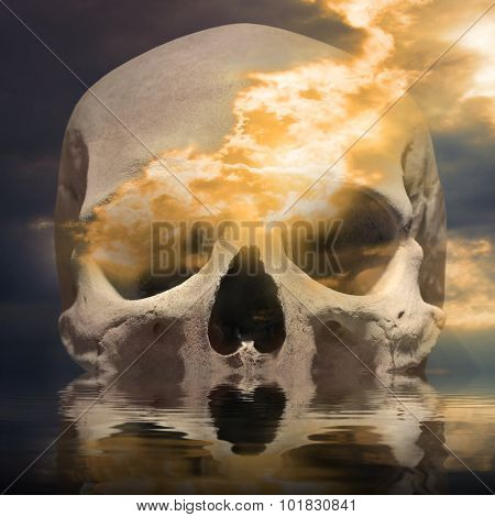 Burning skull in the sea. Background on piracy and smuggling theme.