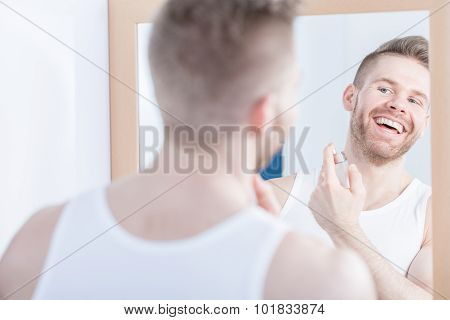 Smiling Man Admiring His Reflection