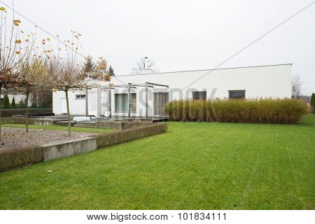 Detached House With Green Lawn