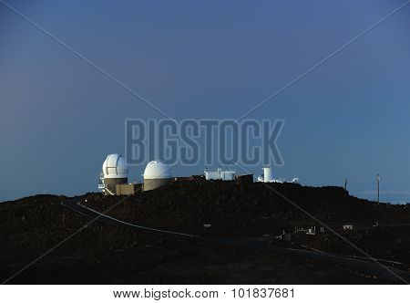 Space Observatories At Sunrise On Top Of Haleakala Crater On Maui.