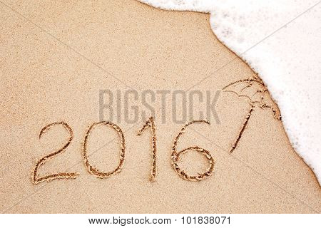 Foaming Sea Wave Coming To Wash Inscription Of The Year 2016 Written In The Wet Yellow Beach Sand
