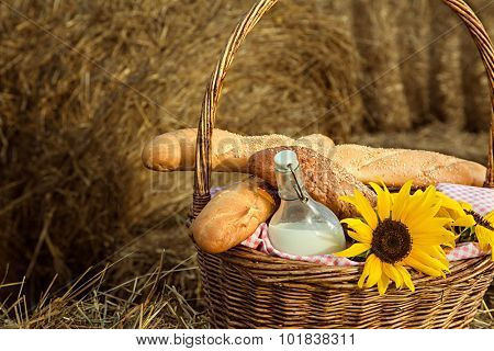 basket of bread and milk in a haystack