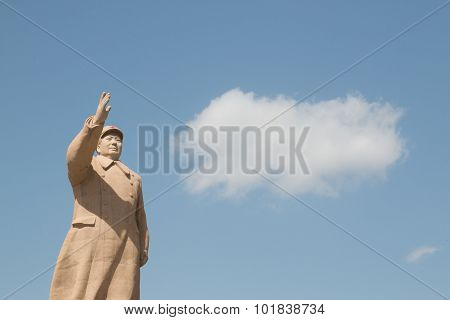 Chairman Mao Statue In Front Of Blue Sky
