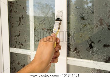 Painting The Window With Brush
