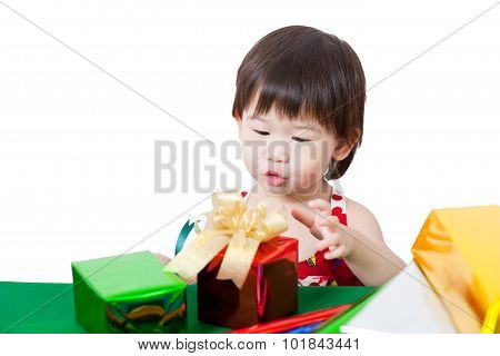 Adorable Little Girl With Present In Chirstmas Day