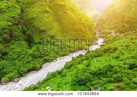 Beautiful Asian landscape with mountain river, bright colors, pristine nature. Nepal