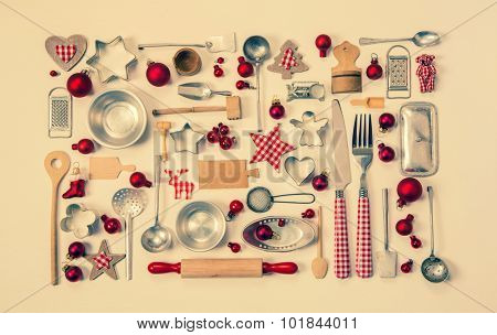 Vintage christmas background with a collection of many red checked miniatures of the kitchen for decoration.