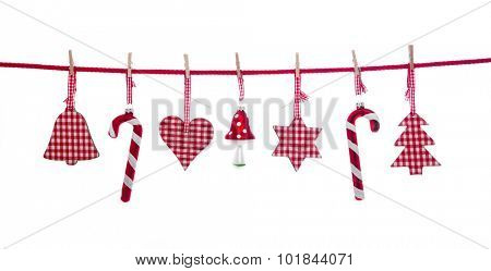 Hanging isolated red and white checkered christmas decoration.