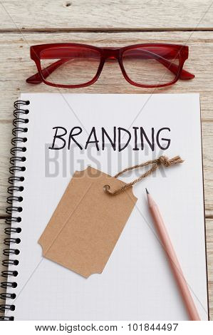 Branding With Brand Tag On Notebook