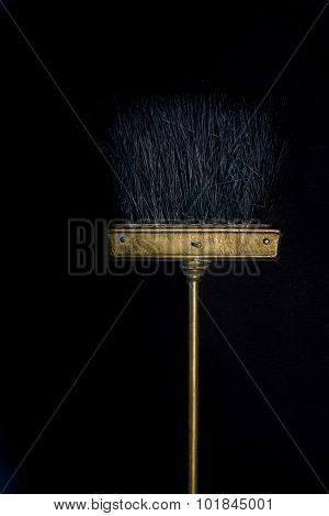 Gloden Small Cooper Broom On Black Background