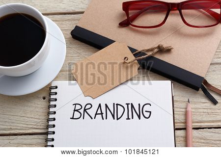 Brand Tag And Notebook With Glasses