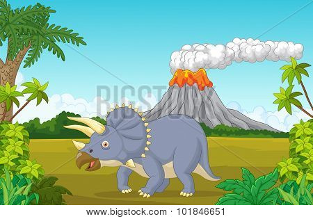 Prehistoric scene with triceratops cartoon and volcano